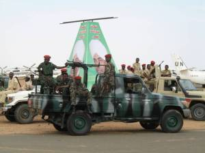 Soldiers wait for President Bashir to arrive in El Fasher, Darfur, last month