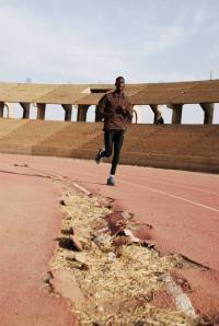 Ismail Ahmed Ismail trains at Khartoum's decrepit athletics stadium
