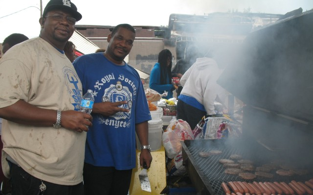 Chef Dada (left) and Deshon Morris feed clean-up gangs in Ferguson on Saturday after another night of disturbances